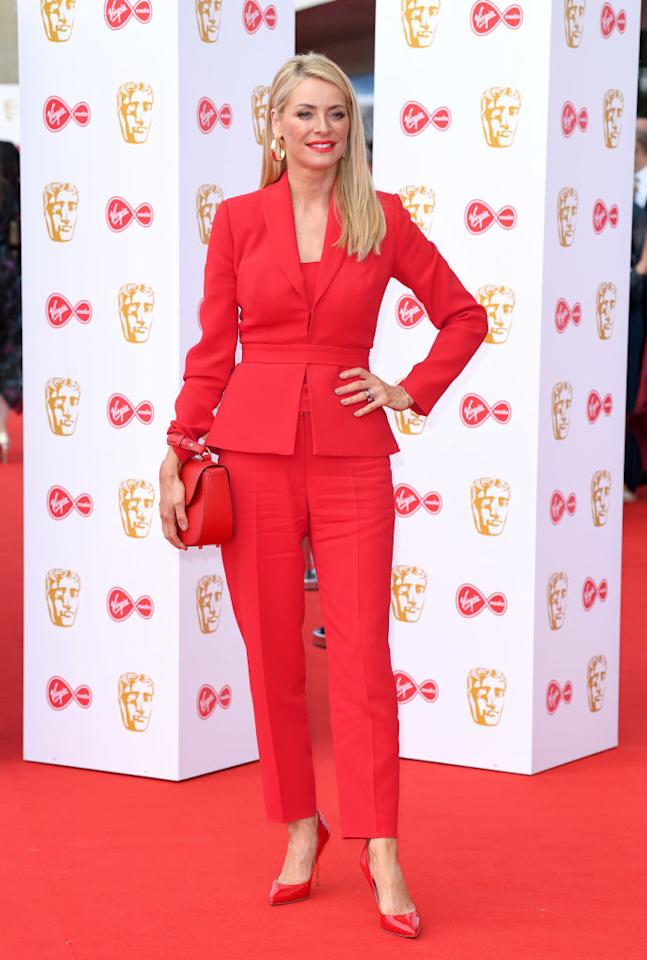 Tess Daly wore a red suit paired with Kurt Geiger heels to attend the Virgin Media British Academy Television Awards 2019 at The Royal Festival Hall on May 12, 2019 in London, England. <em>[Photo: Getty]</em>