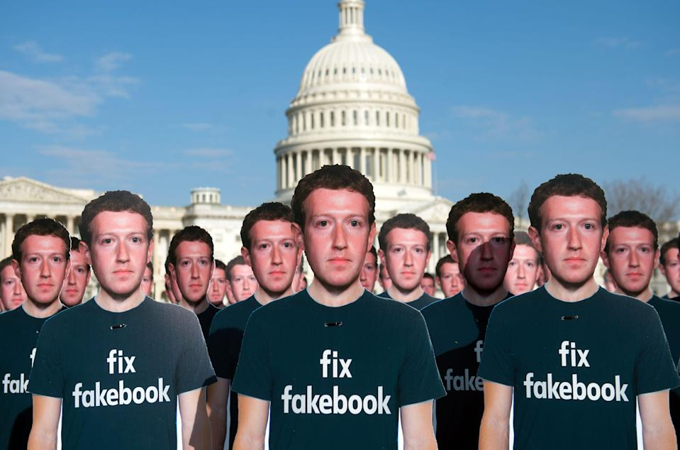 Advocacy group Avaaz placed 100 cardboard cutouts of Facebook founder and CEO Mark Zuckerberg outside the Capitol in Washington in April 2018 to call attention to what the group says are hundreds of millions of fake accounts spreading disinformation on Facebook.