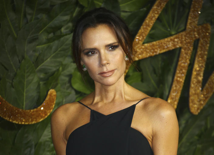 Designer Victoria Beckham poses for photographers upon arrival at the The Fashion Awards 2018 in central London, Monday, Dec. 10, 2018. (Photo by Joel C Ryan/Invision/AP)