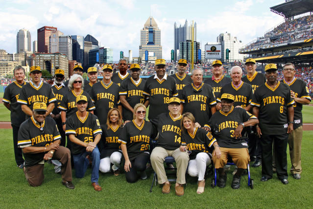 Members of the 1979 Pittsburgh Pirates World Championship team and people involved with the team pose for a photo after a pre-game ceremony honoring the team before a baseball game between the Pittsburgh Pirates and the Philadelphia Phillies in Pittsburgh, Saturday, July 20, 2019. (AP Photo/Gene J. Puskar)