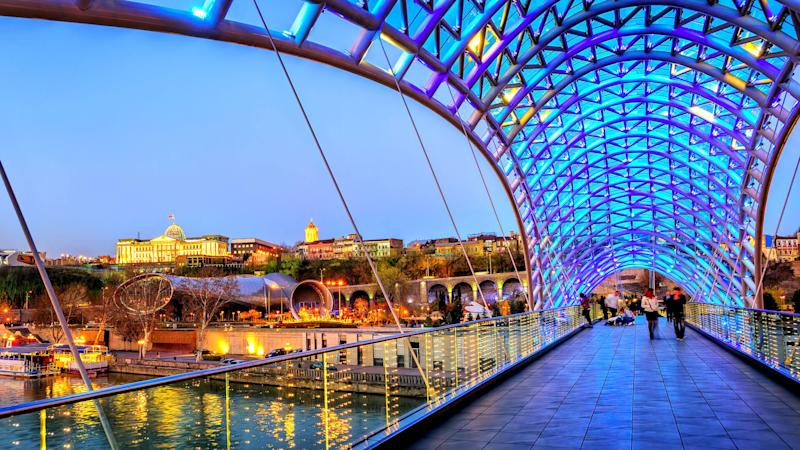Peace Bridge overlooking Trinity Cathedral in Tbilisi Georgia