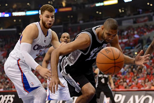LOS ANGELES, CA - MAY 20: Tim Duncan #21 of the San Antonio Spurs and Blake Griffin #32 of the Los Angeles Clippers go after a loose ball in the first quarter in Game Four of the Western Conference Semifinals in the 2012 NBA Playoffs on May 20, 2011 at Staples Center in Los Angeles, California. NOTE TO USER: User expressly acknowledges and agrees that, by downloading and or using this photograph, User is consenting to the terms and conditions of the Getty Images License Agreement. (Photo by Harry How/Getty Images)