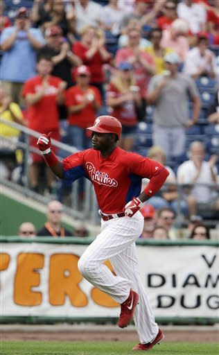 Philadelphia Phillies' Domonic Brown reacts as he rounds the bases after hitting a home run off New York Yankees Zach Nuding during the seventh inning of a spring training exhibition baseball game, Tuesday, Feb. 26, 2013, in Clearwater, Fla. Philadelphia won 4-3. (AP Photo/Matt Slocum)