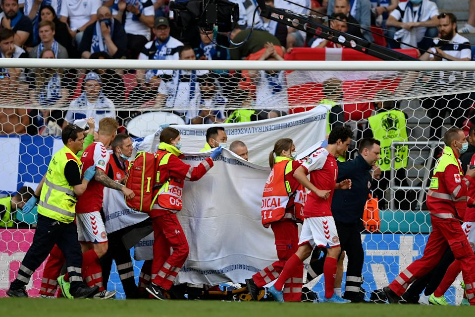 Denmark's Christian Eriksen is taken away on a stretcher after collapsing on the pitch (Reuters)