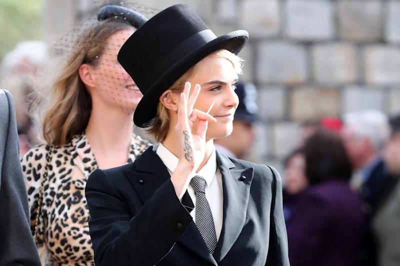 Chic: Delevingne tied the look together with a top hat PA
