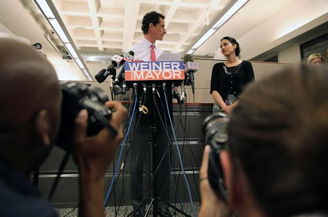NEW YORK, NY - JULY 23: Anthony Weiner (C), a leading candidate for New York City mayor, stands with his wife Huma Abedin at a press conference on July 23, 2013 in New York City. Weiner addressed news of new allegations that he engaged in lewd online conversations with a woman after he resigned from Congress for similar previous incidents. (Photo by John Moore/Getty Images)
