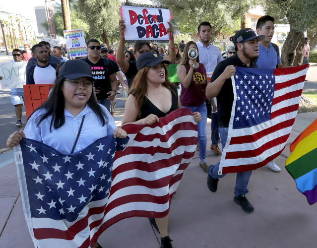 <p>Deferred Action for Childhood Arrivals (DACA) supporters march to the Immigration and Customs Enforcement office to protest shortly after U.S. Attorney General Jeff Sessions' announcement that the Deferred Action for Childhood Arrivals (DACA), will be suspended with a six-month delay, Tuesday, Sept. 5, 2017, in Phoenix. (Photo: Matt York/AP) </p>