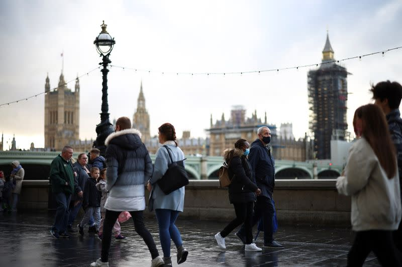People walk along the South Bank, amid the coronavirus disease (COVID-19) outbreak, in London
