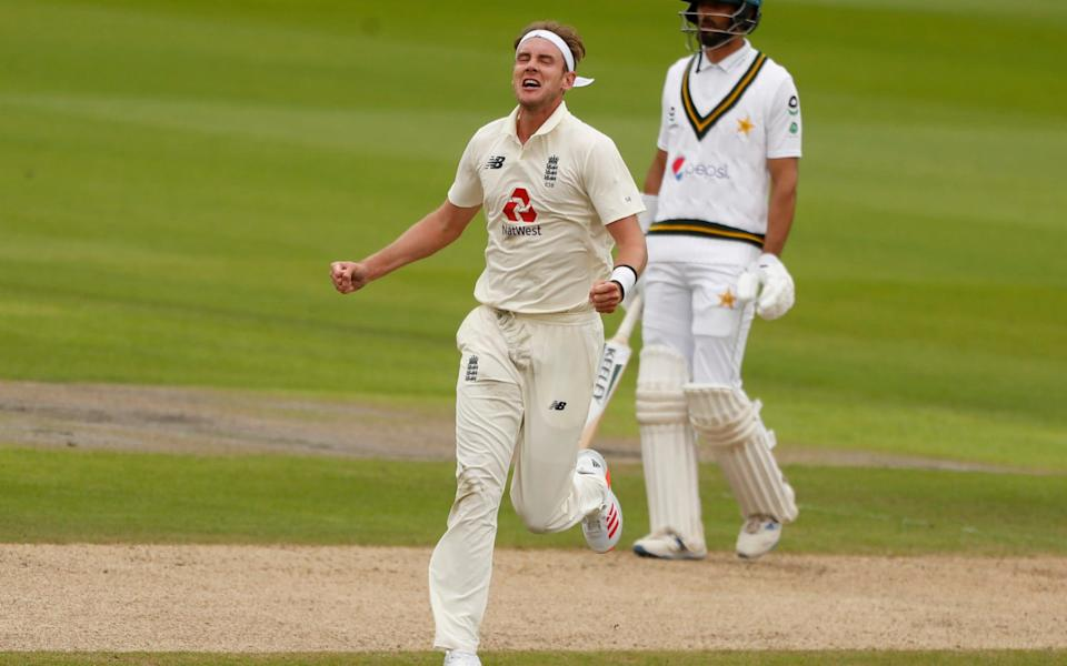 England's Stuart Broad, left, celebrates the dismissal of Pakistan's Asad Shafiq  - REUTERS