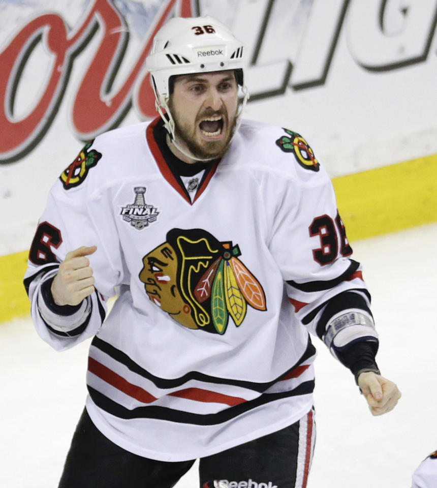 Chicago Blackhawks center Dave Bolland (36) celebrates his game winning goal against the Boston Bruins during the third period in Game 6 of the NHL hockey Stanley Cup Finals, Monday, June 24, 2013, in Boston. The Blackhawks won 3-2. (AP Photo/Charles Krupa)