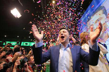 Ukrainian presidential candidate Volodymyr Zelenskiy reacts following the announcement of the first exit poll in a presidential election at his campaign headquarters in Kiev, Ukraine April 21, 2019. REUTERS/Stringer