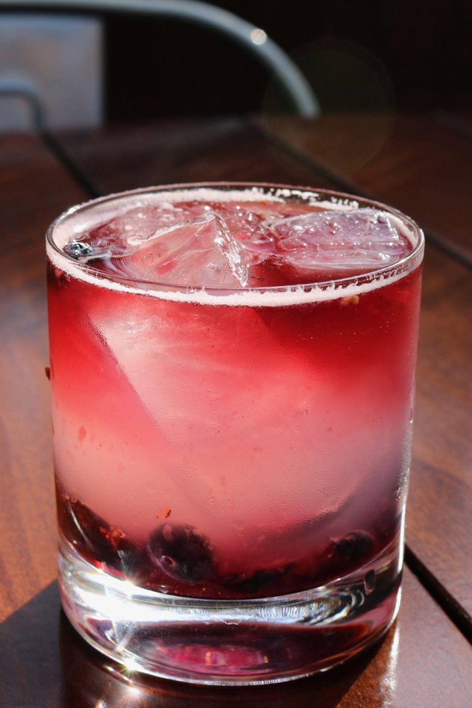 """<p><strong>Ingredients</strong></p><p>8-10 blueberries<br>2 oz Long Island Vodka<br>1 oz fresh lemon juice<br>1 oz simple syrup<br>1-2 oz Oregon Pinot Noir</p><p><strong>Instructions</strong></p><p>Muddle fresh blueberries at the bottom of a double old fashioned glass and top with ice. Add vodka, lemon, and simple syrup to a mixing glass and shake vigorously. Strain over ice and blueberries. Pour wine over a spoon to create a red wine """"float.""""</p><p><em>From <a href=""""https://www.kingsleynyc.com/"""" rel=""""nofollow noopener"""" target=""""_blank"""" data-ylk=""""slk:Kingsley"""" class=""""link rapid-noclick-resp"""">Kingsley</a> in New York City</em></p><p><strong>More</strong>: <a href=""""https://www.townandcountrymag.com/leisure/drinks/g19576401/fruity-alcoholic-drinks/"""" rel=""""nofollow noopener"""" target=""""_blank"""" data-ylk=""""slk:Fruity Cocktails That Are Mouth-Wateringly Delicious"""" class=""""link rapid-noclick-resp"""">Fruity Cocktails That Are Mouth-Wateringly Delicious</a></p>"""