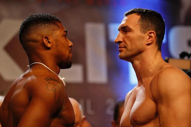 Wladimir Klitschko (R) has recorded a video predicting the outcome of the fight against Anthony Joshua which will be sealed in his robe then auctioned for charity (AFP Photo/Adrian DENNIS)