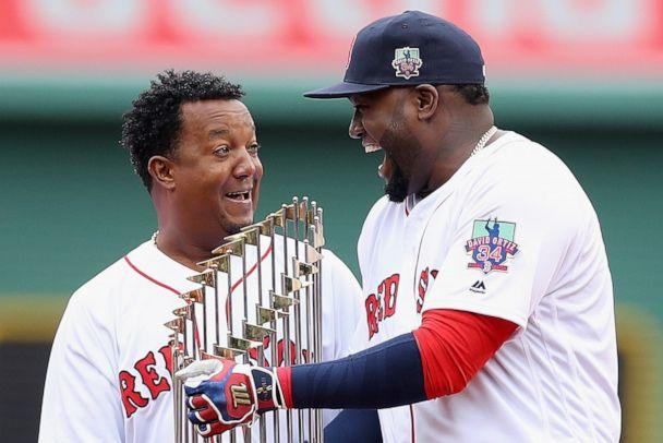 PHOTO: Boston Red Sox's Pedro Martinez and David Ortiz laugh during the pregame ceremony to honor Ortiz's retirement before his last regular season home game at Fenway Park, Oct. 2, 2016 in Boston. (Maddie Meyer/Getty Images, FILE)