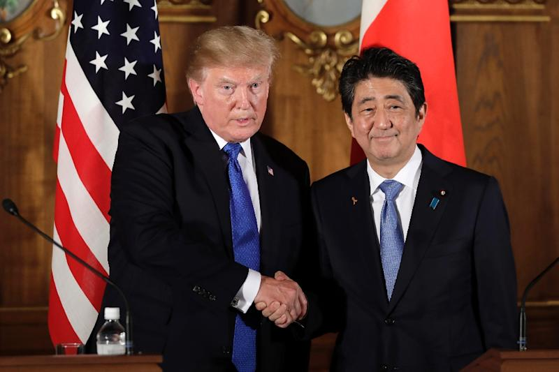 Few leaders have courted the US president as furiously as Abe (AFP Photo/Kiyoshi Ota)