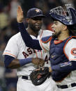 Houston Astros' Robinson Chirinos, right, and Yordan Alvarez celebrate after a baseball game against the Oakland Athletics Monday, Sept. 9, 2019, in Houston. The Astros won 15-0. (AP Photo/David J. Phillip)