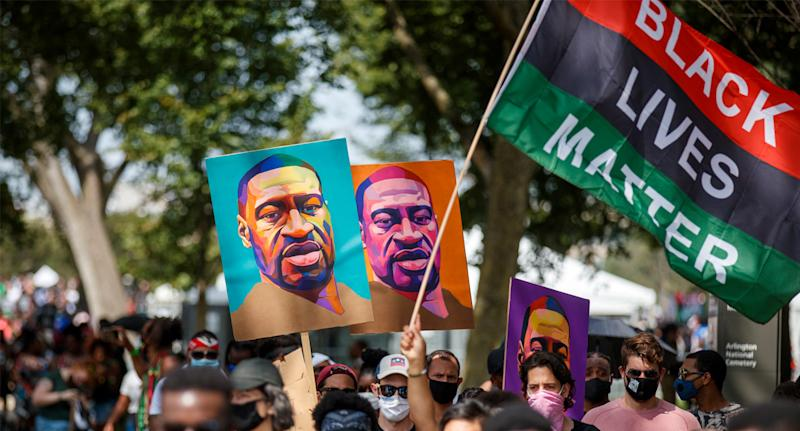 Protesters and activists carrying portraits of George Floyd attend the 'Commitment March: Get Your Knee Off Our Necks' march. Source: AAP