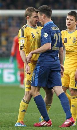 France's Laurent Koscielny argues with Ukraine's Olexandr Kucher during their 2014 World Cup qualifying first leg playoff soccer match at the Olympic stadium in Kiev