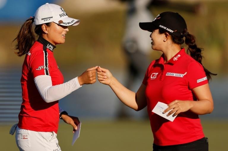 Ko Jin-young fist-bumps fellow South Korean Kim Sei-young on the 18th green in the second round of the LPGA Tour Championship
