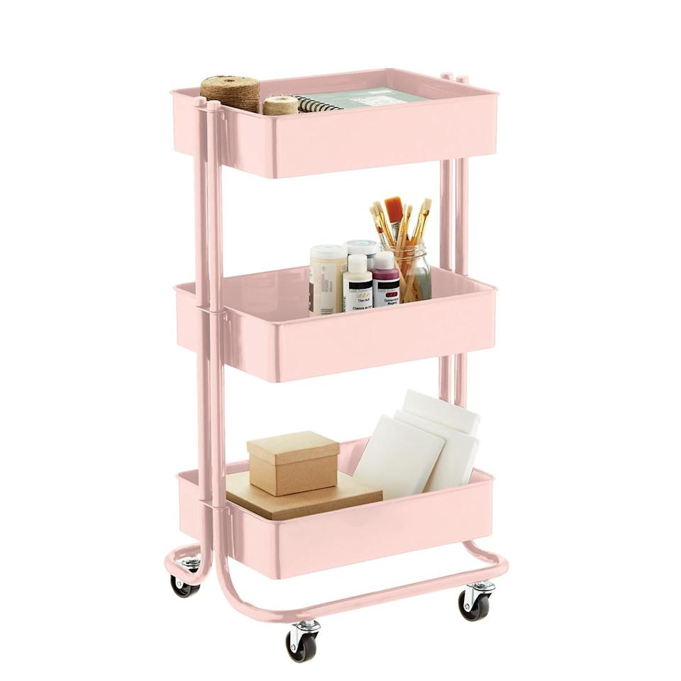 """<p>This <a href=""""https://www.popsugar.com/buy/Blush-3-Tier-Rolling-Cart-484277?p_name=Blush%203-Tier%20Rolling%20Cart&retailer=containerstore.com&pid=484277&price=30&evar1=casa%3Aus&evar9=46542507&evar98=https%3A%2F%2Fwww.popsugar.com%2Fhome%2Fphoto-gallery%2F46542507%2Fimage%2F46543031%2FBlush-3-Tier-Rolling-Cart&list1=shopping%2Corganizing%2Corganization%2Csmall%20space%20living%2Chome%20organization%2Chome%20shopping&prop13=api&pdata=1"""" rel=""""nofollow"""" data-shoppable-link=""""1"""" target=""""_blank"""" class=""""ga-track"""" data-ga-category=""""Related"""" data-ga-label=""""https://www.containerstore.com/s/whats-new/blush-3-tier-rolling-cart/1d?productId=11010940"""" data-ga-action=""""In-Line Links"""">Blush 3-Tier Rolling Cart</a> ($30) is great for a bathroom or art room.</p>"""