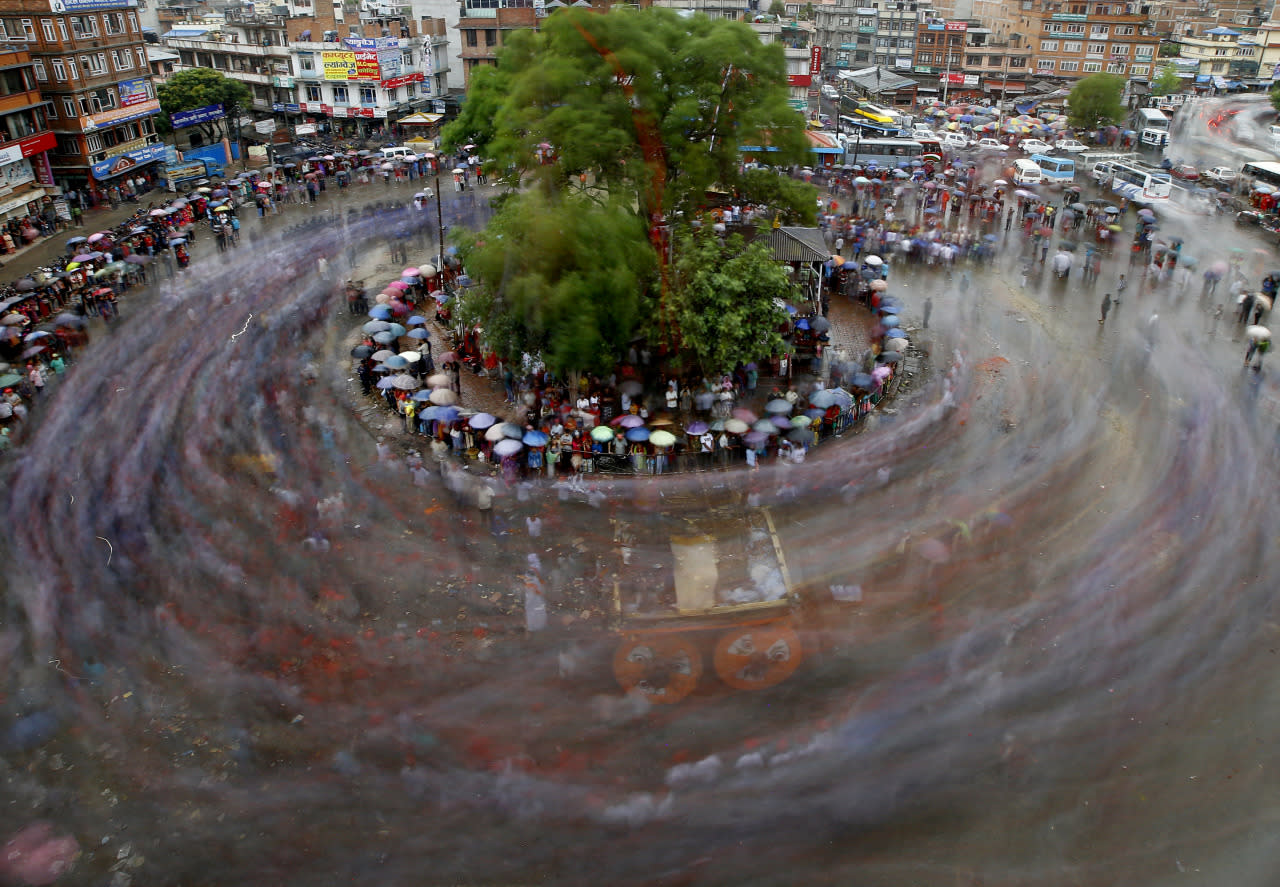 <p>Nepalese devotees pull a giant wooden chariot in a circle to celebrate Rato Machhindranath, the god of rain, during a festival in Lalitpur, near Kathmandu, Nepal, on May 17, 2016. The festival celebrates the hope of a good harvest, prosperity and good luck for the coming year. (Narendra Shrestha/EPA)<br /></p>
