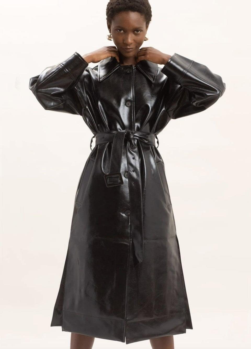 <p><span>The Frankie Shop Glossy Patent Faux Leather Belted Coat</span> ($315)</p>
