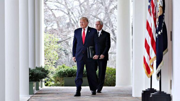 PHOTO: President Donald Trump arrives with Vice President Mike Pence to declare a national emergency due to the COVID-19 coronavirus pandemic, in the Rose Garden of the White House, in Washington, March 13, 2020. (Michael Reynolds/EPA via Shutterstock)