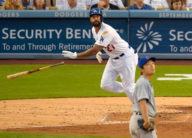 Los Angeles Dodgers' Matt Kemp, left, hits a two-run home run as Chicago Cubs starting pitcher Tsuyoshi Wada, of Japan, looks on during the fourth inning of a baseball game, Saturday, Aug. 2, 2014, in Los Angeles. (AP Photo/Mark J. Terrill)