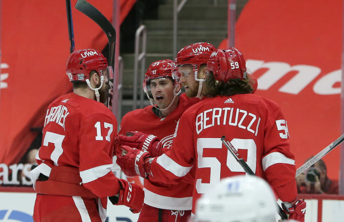 Detroit Red Wings right wing Anthony Mantha, second from right, celebrates his second-period goal against the Columbus Blue Jackets with defenseman Filip Hronek (17), center Dylan Larkin (71), and left-wing Tyler Bertuzzi (59) during an NHL hockey game Tuesday, Jan. 19, 2021, in Detroit. (AP Photo/Duane Burleson)