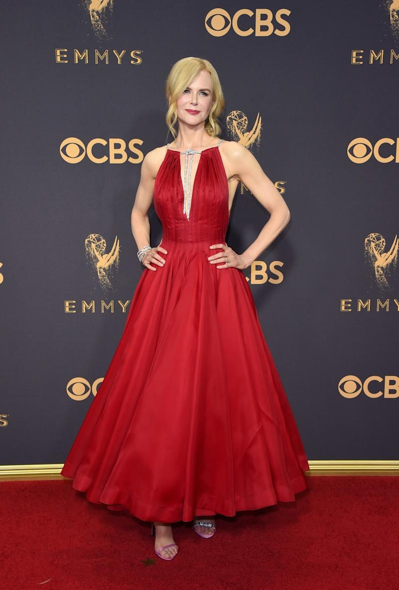 Nicole Kidman wore a red tea-length gown by Calvin Klein By Appointment, designed by Raf Simons, to the 69th Annual Primetime Emmy Awards at Microsoft Theater on September 17, 2017 in Los Angeles, California. (Photo by John Shearer/WireImage)