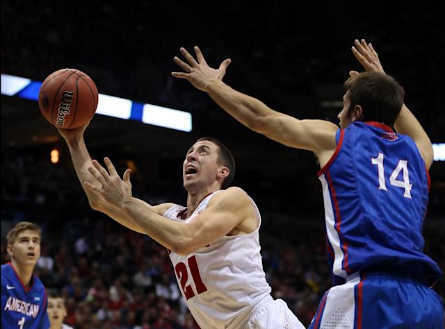 MILWAUKEE, WI - MARCH 20: Josh Gasser #21 of the Wisconsin Badgers shoots as Jesse Reed #14 of the American University Eagles defends during the second round game of NCAA Basketball Tournament at BMO Harris Bradley Center on March 20, 2014 in Milwaukee, Wisconsin. (Photo by Jonathan Daniel/Getty Images)