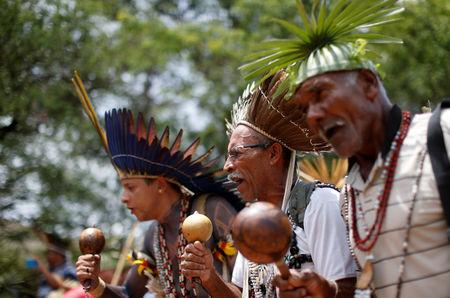 FILE PHOTO: Indigenous people from various tribes dance as they wait to deliver a letter to Brazil's President-elect Jair Bolsonaro at a transitional government building in Brasilia, Brazil, December 6, 2018. REUTERS/Adriano Machado