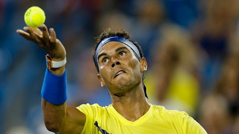 Nadal focuses intensely on the ball when serving. Pic: Getty