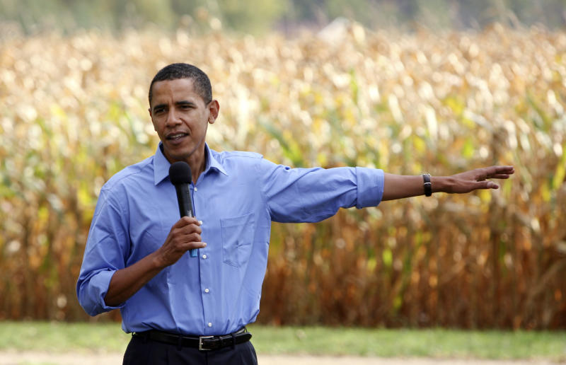 FILE - In this Oct. 5, 2007, file photo then Democratic presidential hopeful Sen. Barack Obama, D-Ill., speaks to residents near a corn field in New Hampton, Iowa. Obama used his corn-state background and strong support for increased ethanol production to set himself apart from Hillary Clinton in the 2008 Democratic presidential campaign. (AP Photo/Charlie Neibergall, FILE)