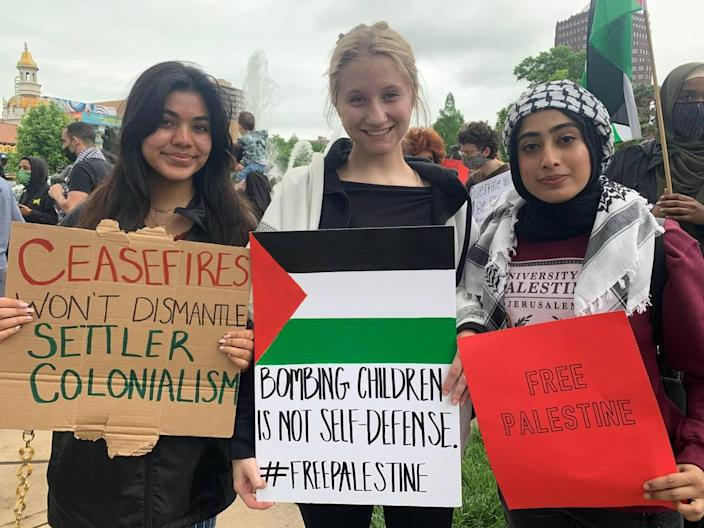 Amreen Hasan, 21, Kat Schneider, 20, and Amber Gillani, 19, from left to right, attended the protest on the Country Club Plaza in support of Palestinian people on Saturday, May 22.