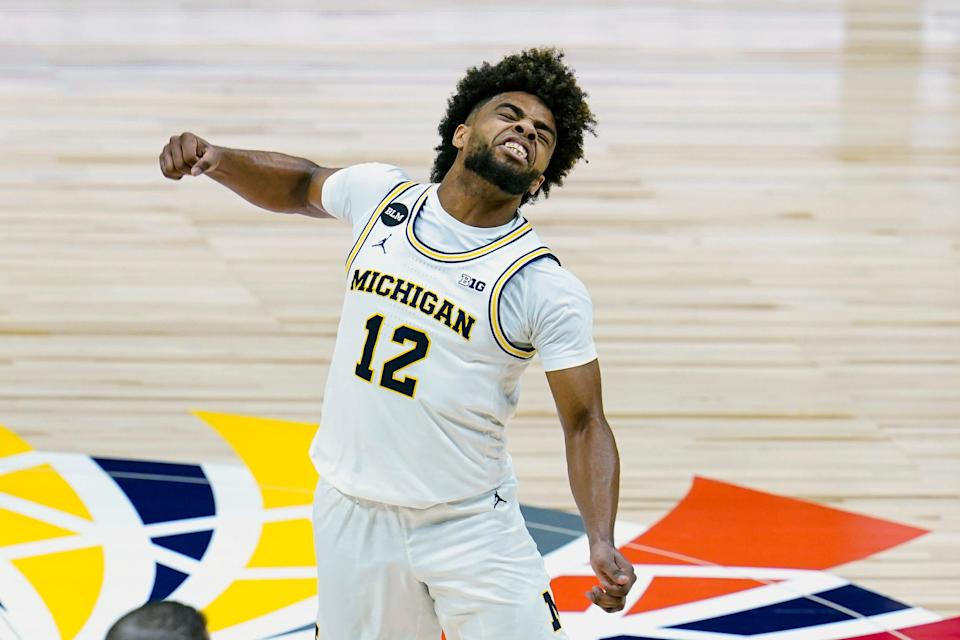 Mike Smith celebrates as Michigan took the lead at halftime against Maryland at the Big Ten tournament in Indianapolis, Friday, March 12, 2021.