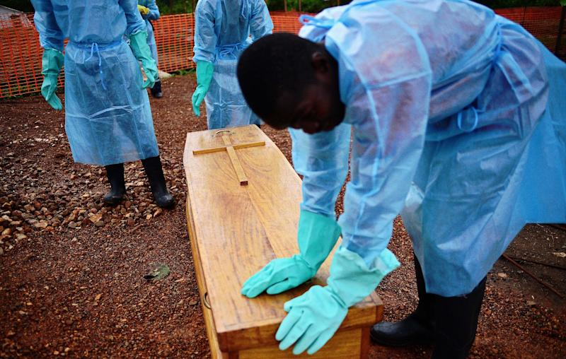 Government burial team members close the coffin of Dr Modupeh Cole at the MSF facility in Kailahun, Sierra Leone on August 14, 2014