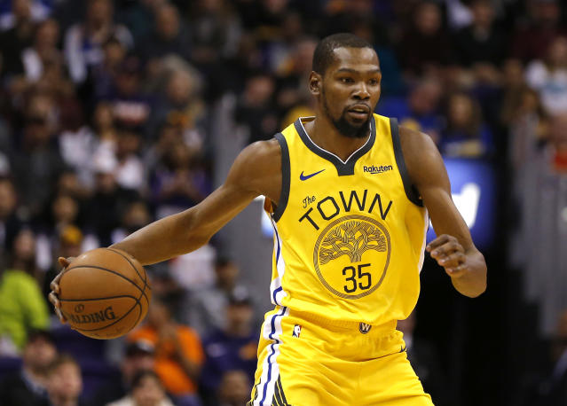 "<a class=""link rapid-noclick-resp"" href=""/nba/players/4244/"" data-ylk=""slk:Kevin Durant"">Kevin Durant</a> isn't focused on rumors that he may sign with the <a class=""link rapid-noclick-resp"" href=""/nba/teams/nyk"" data-ylk=""slk:New York Knicks"">New York Knicks</a> next summer in free agency. He just wants to play basketball now. (AP/Rick Scuteri)"