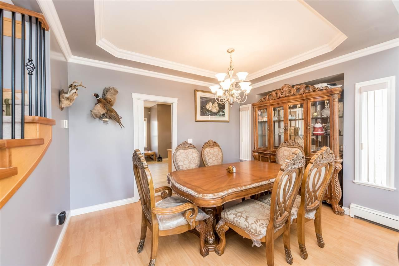 """<p><a rel=""""nofollow"""">14603 67A Ave., Surrey, B.C.</a><br /> The main floor has high ceilings and a large living and dining area.<br /> (Photo: Zoocasa) </p>"""