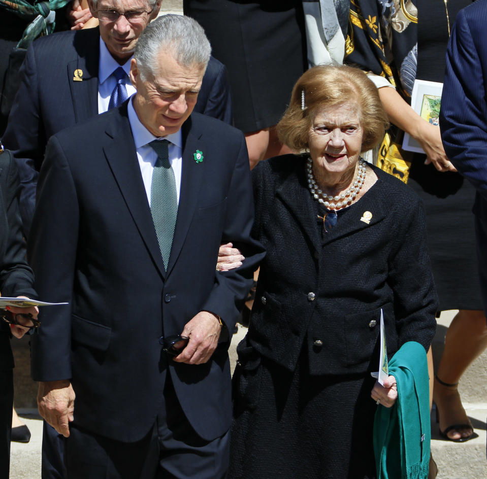 FILE— In this April 18, 2017, file photo, Pittsburgh Steelers owner Art Rooney II, left, escorts his mother, Patricia Rooney, following a funeral Mass for his father and Patricia's husband, Dan Rooney, in Pittsburgh. Patricia Rooney, the wife of late Pittsburgh Steelers chairman Dan Rooney, has died. She was 88. The Steelers said in a statement that Rooney died peacefully at her home Saturday, Jan. 30, 2021. A cause of death was not given. (AP Photo/Gene J. Puskar, File)