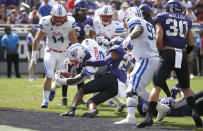 SMU running back Ke'Mon Freeman (2) goes across the goal line to score a two point conversion as TCU safety Ar'Darius Washington (27) tries to stop him during the first half of an NCAA college football game Saturday, Sept. 21, 2019, in Fort Worth, Texas. (AP Photo/Ron Jenkins)