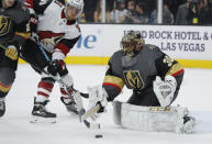 Vegas Golden Knights goaltender Malcolm Subban (30) makes a save beside Arizona Coyotes right wing Michael Grabner (40) during the first period of an NHL hockey game Friday, Nov. 29, 2019, in Las Vegas. (AP Photo/John Locher)