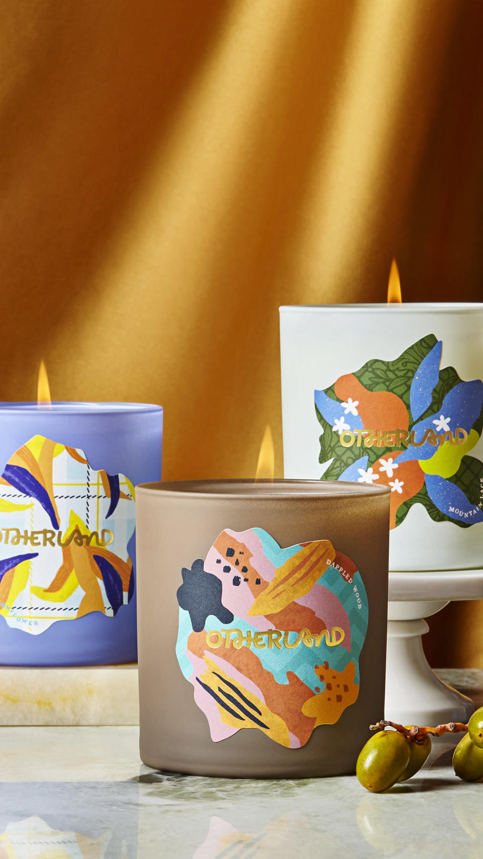 This photo provided by Otherland shows candles from the Manor House Weekend Fall Collection. Otherland's Manor House Weekend Fall candle collection features scents like sweet hay, corn silk, pear, cardamom and maple – a perfect welcoming gift for friends moving into a new home this fall. (Otherland via AP)