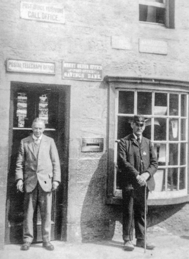 Matthew Hogart, postmaster from 1908 to 1983, and postman George Stoddart at Sanquhar Post Office (Picture: SWNS)