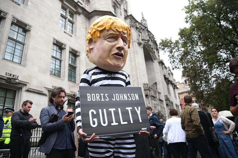 Protestor dressed as Boris Johnson holding a guilty sign after the Supreme Court ruled that the prorogation of Parliament was unlawful on September 24, 2019. (Getty)