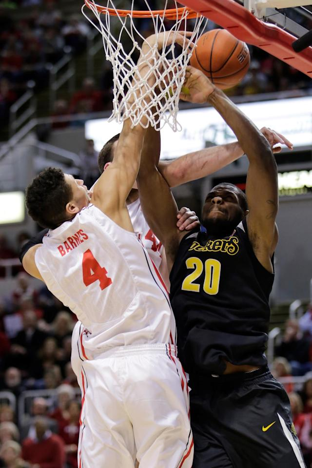 Wichita State center Kadeem Coleby (20) shoots under pressure from Bradley forward Auston Barnes (4) during the first half of an NCAA college basketball game at Carver Arena Tuesday, Feb. 25, 2014, in Peoria, Ill. (AP Photo/ Stephen Haas)