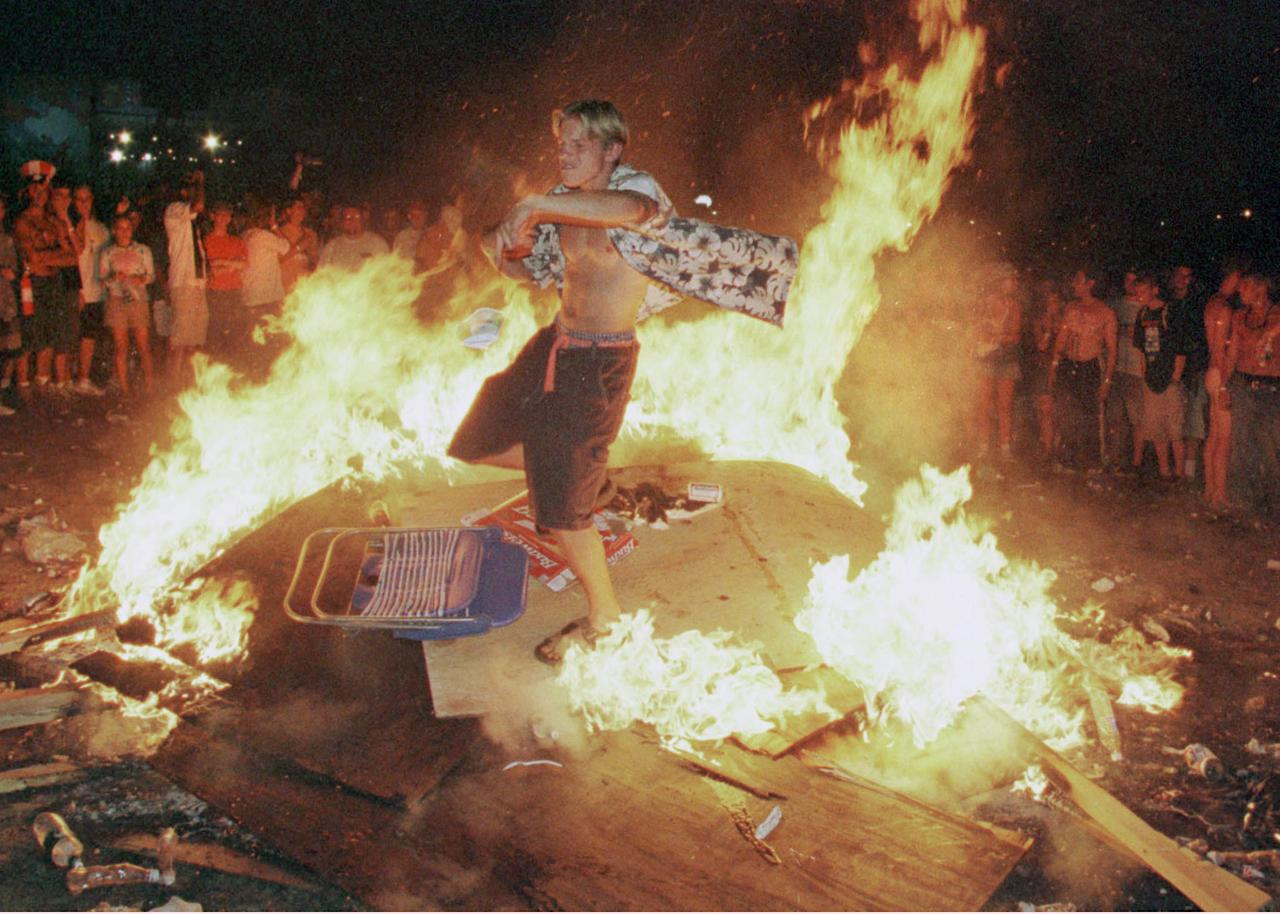 Rome, New York A Young Man Dances In A Fire That Burns Into The Early Morning Hours Following The Close Of The Woodstock Music And Arts Festival In Rome, Ny, July 26. The Fans Are Burning Huge Plywood Panels That Had Been The Woodstock Peace Wall. The 30Th Anniversary Festival, Was Staged At The Former Griffiss Air Force Base.  (Photo By Joe Traver/Getty Images)