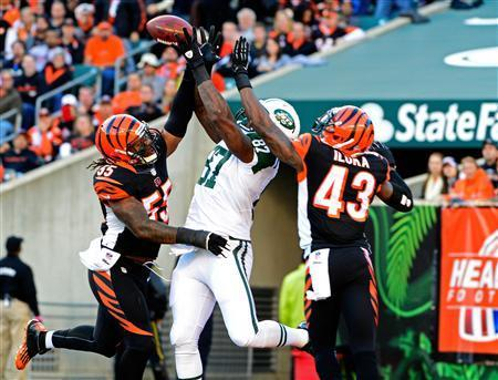 New York Jets tight end Jeff Cumberland (87) misses a catch as heis defended by Cincinnati Bengals outside linebacker Vontaze Burfict (55) and strong safety George Iloka (43) in the end zone during the first half at Paul Brown Stadium. Mandatory Credit: Marc Lebryk-USA TODAY Sports