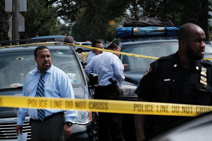 Police converge on the scene of a shooting in Brooklyn, one of numerous during the day, on July 14, 2021, in New York City. State officials have said they would offer 4,000 summer and full-time jobs with training for youth in high-crime neighborhoods in an effort to reduce violence.