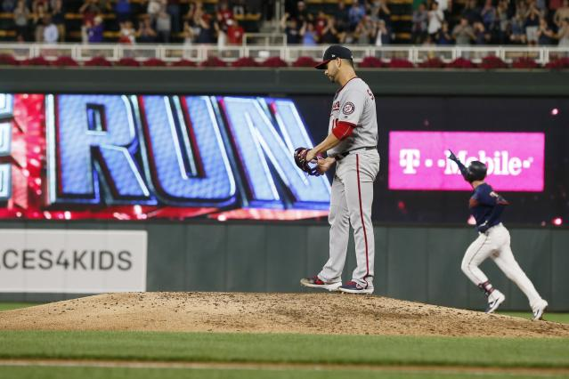 Minnesota Twins' Mitch Garver, background right, rounds the bases on a two-run home run off Washington Nationals pitcher Anibal Sanchez, left, in the seventh inning of a baseball game Tuesday, Sept. 10, 2019, in Minneapolis. (AP Photo/Jim Mone)